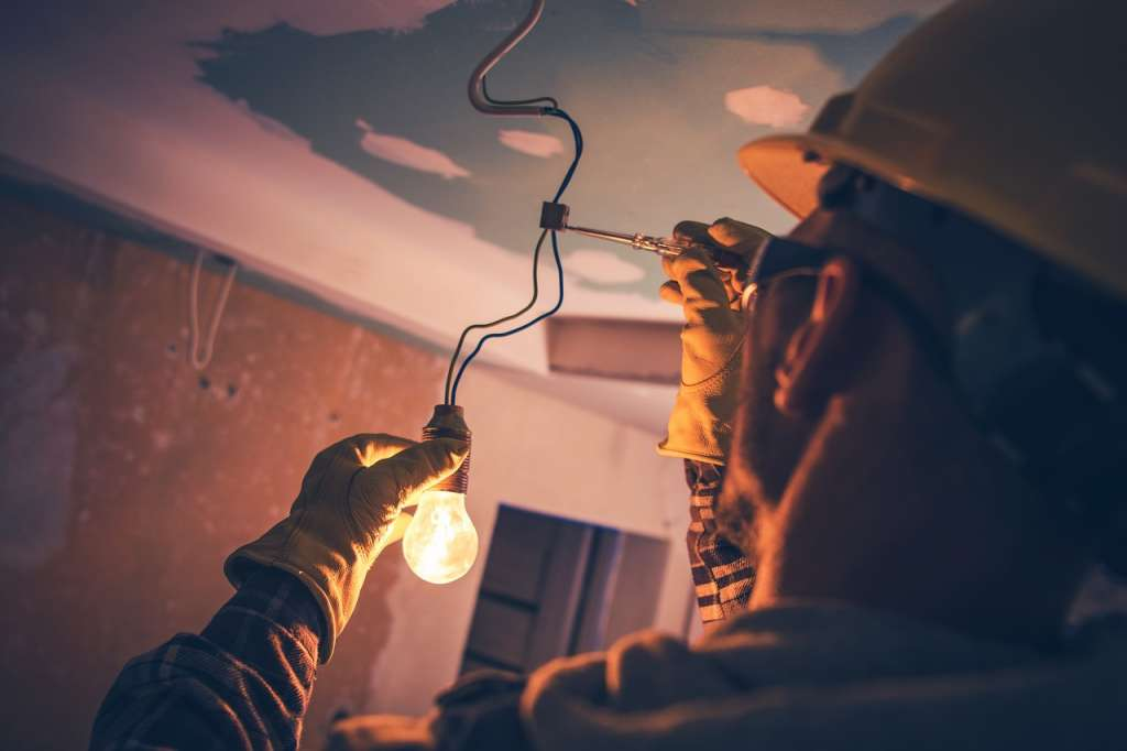 electrician wearing safety gear while at work